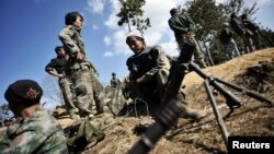 FILE - Kachin rebels are seen manning their positions at near Mai Ja Yang, Kachin state.