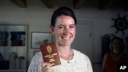 Norwegian Marte Deborah Dalelv, 24, shows her passport at the Norwegian Seaman's Club in Dubai, United Arab Emirates, July 22, 2013.