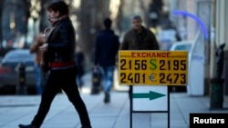 A currency exchange rate is displayed on the street in Tbilisi, Feb. 23, 2015.