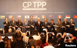 Đại diện 11 thành viên CPTPP tại một buổi lễ hồi tháng 3/2018