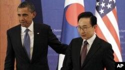 奥巴马总统3月25日在韩国首都首尔与韩国总统李明博会晤