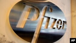 FILE - The Pfizer company logo is photographed at Pfizer Inc. headquarters, in New York, Dec. 4, 2017.