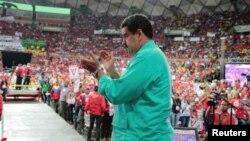 Venezuela's President Nicolas Maduro applauds as he attends a rally in Caracas, Venezuela, June 11, 2016.