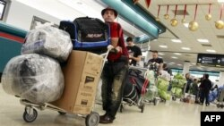 Putnici na medjunarodnom aerodromu u Majamiju.