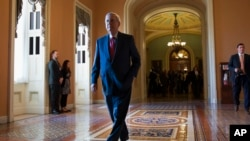 FILE - Senate Majority Leader Mitch McConnell of Ky. walks to his office on Capitol Hill in Washington.