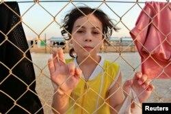 2012年7月31日叙利亚边境附近难民营里的小女孩。