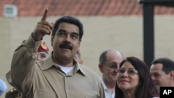 El presidente Nicolás Maduro y su esposa Cilia Flores en Puerto Ordaz, Venezuela. Agosto 11, 2016.