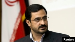 "FILE - Tehran Prosecutor General Saeed Mortazavi speaks to journalists in Tehran April 19, 2009. A court found him guilty of ""abetting and aiding"" the torture and deaths of protesters arrested in 2009."