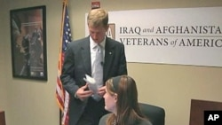Tim Embree, a reservist who served two combat tours in Iraq and now works for the reputable Iraq Afghanistan Veterans Association (IAVA), speaks with a colleague, February 2011