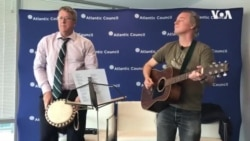 South African Author Greg Mills Performs With Singer Robin Auld in Washington DC