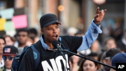 Xothitl Johnson addresses a crowd of protesters before a speaking engagement by Ben Shapiro on the campus of the University of California, Berkeley in Berkeley, Calif., Sept. 14, 2017.