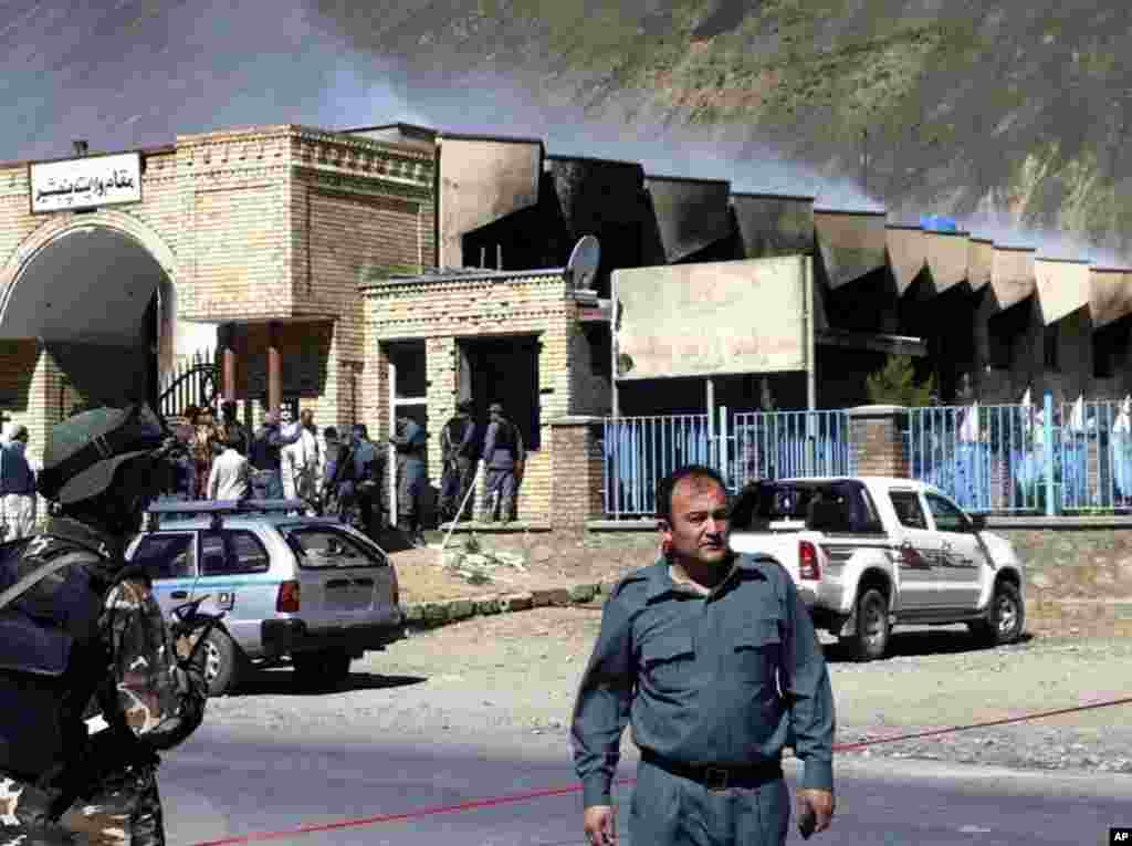 A police officer at the scene of an attack on a government compound in Panjshir, Afghanistan, May 29, 2013.