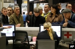 People gather at the airline information desk at of Russian airline Kogalymavia's desk at Pulkovo airport in St.Petersburg, Russia, Oct. 31, 2015,