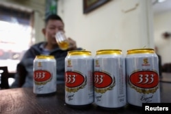 FILE - A man drinks Sabeco's 333 beer at a restaurant in Hanoi, Vietnam, Dec. 18, 2017.