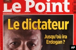 "A photo dated May 30, 2018, shows a part of the front cover of French weekly news magazine ""Le Point"" featuring Turkish President Recep Tayyip Erdogan and the headline ""Le dictateur,"" in Paris, France."