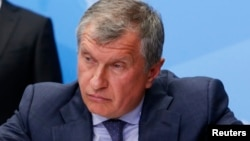 FILE - Rosneft CEO Igor Sechin at the St. Petersburg International Economic Forum 2014 in St. Petersburg, May 24, 2014.