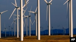 FILE - A wind turbine farm owned by PacifiCorp near Glenrock, Wyoming, produces electricity, May 6, 2013.