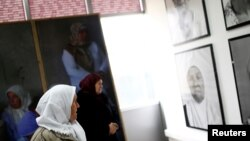Survivors of the 1995 Srebrenica massacre look at a Dutch-designed exhibition that opened near the former U.N. safe base in Potocari near Srebrenica, Bosnia and Herzegovina, Feb. 9, 2017.