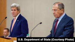 FILE - U.S. Secretary of State John Kerry, left, and Russian Foreign Minister Sergei Lavrov address reporters following a meeting focused on the Syrian civil war, in Geneva, Aug. 26, 2016.