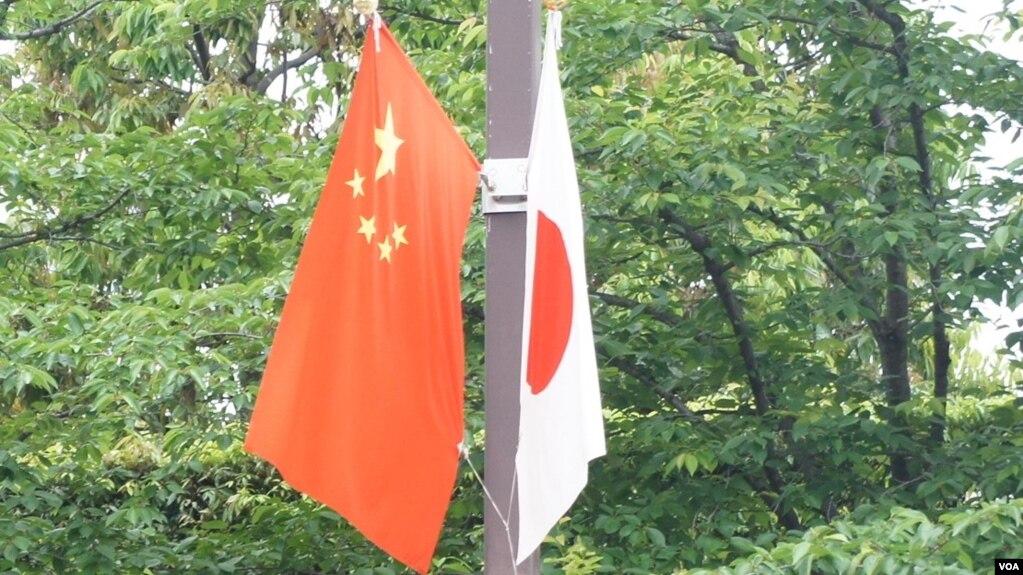 李克強訪日令東京街頭8年來重現日中國旗