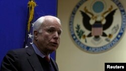 U.S. Senator John McCain speaks during a news conference at the U.S. embassy in Kabul, Afghanistan, Jan. 2, 2014.