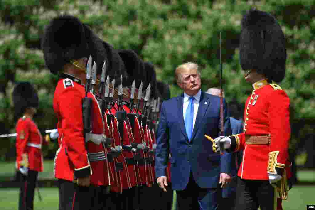 U.S. President Donald Trump inspects an honor guard during a welcome ceremony at Buckingham Palace in central London on the first day of his three-day state visit to the UK.