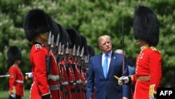 US President Donald Trump inspects an honour guard during a welcome ceremony at Buckingham Palace in central London on June 3, 2019, on the first day of their three-day State Visit to the UK.