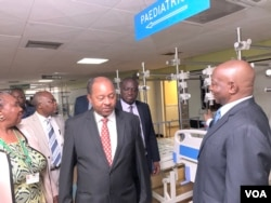 Zimbabwe Health Minister Obediah Moyo, center, lauded the doctors' return to work Thursday.