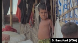 A young Rohingya boy at Kutupalong refugee camp in Cox's Bazaar, Bangladesh.