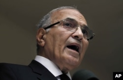 FILE - In this May 26, 2012 file photo, then Egyptian presidential candidate Ahmed Shafik speaks during a press conference at his office in Cairo, Egypt.