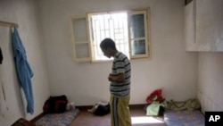 In this Sept. 22, 2011 file photo, a man suspected of being a Gadhafi loyalist prays in a detention facility in Misrata, Libya.