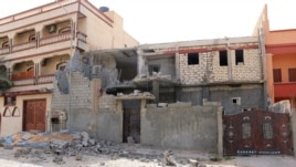 Damage to a house is seen following clashes between rival militias in the Janzour district on the outskirts of Tripoli, August 5, 2014.