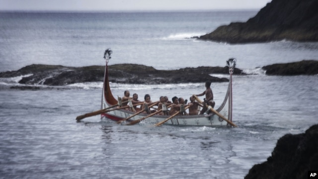 Aboriginal men of the Tao tribe take a newly launched fishing boat on a maiden voyage during a fishing boat launching ceremony on Orchid Island, Taiwan, June 14, 2008.