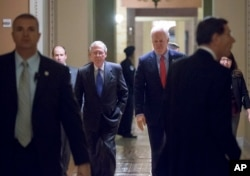 Senate Majority Leader Mitch McConnell, R-Ky., left, and Majority Whip John Cornyn, R-Texas, return to the chamber Dec. 3, 2015, during a marathon series of rapid votes on Capitol Hill in Washington.