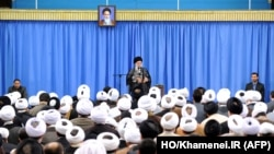 A handout picture released by the official website of the Center for Preserving and Publishing the Works of Iran's Supreme Leader Ayatollah Ali Khamenei, shows him delivering a speech in Tehran, Sept. 27, 2015.