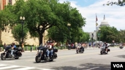 Participants in the Rolling Thunder annual motorcycle rally ride past the National Museum of the American Indian during the parade ahead of Memorial Day in Washington, May 29, 2016. (S. Verma/VOA)