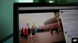 A computer screen displays the social media posting by Mark Zuckerberg on Facebook in Beijing, China, Friday, March 18, 2016. The photo of Facebook founder Mark Zuckerberg jogging in downtown Beijing's notorious smog has prompted a torrent of astonishment