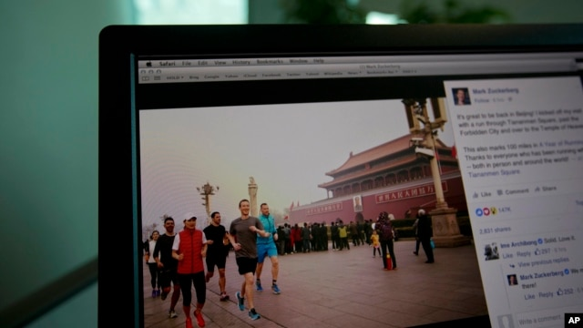 A computer screen displays the social media posting by Mark Zuckerberg on Facebook in Beijing, China, Friday, March 18, 2016.