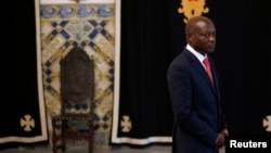 FILE - Guinea-Bissau President Jose Mario Vaz arrives to speak at the presidential palace in Lisbon, Spain.