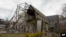The ChristChurch Cathedral remains in ruins in Christchurch, New Zealand, Sept. 5, 2017, following a Feb. 22, 2011, earthquake. On Saturday, the Anglican church made a decision to rebuild the cathedral, strengthening it for future quakes and adding improvements but otherwise leaving the basic design intact.