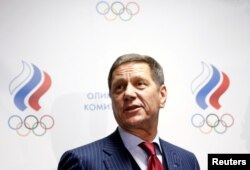 FILE - Russian Olympic Committee head Alexander Zhukov leaves a meeting about the Russian athletics team and federation held by the executive committee of the Russian Olympic Committee in Moscow, Russia, Nov. 18, 2015.
