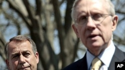 House Speaker John Boehner listens at left, as Senate Majority Leader Harry Reid speaks to reporters outside the White House, April 7, 2011
