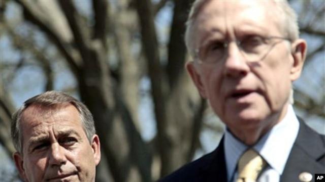 House Speaker John Boehner listens at left, as Senate Majority Leader Harry Reid speaks to reporters outside the White House, April 7, 2011