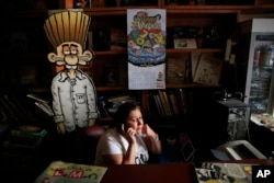 A worker at the office building housing the Turkish satirical cartoon magazine Leman talks on the phone in Istanbul, July 25, 2016. A printed edition about the failed coup attempt was prevented from being distributed last week by Turkish authorities.