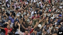 Anti-government protestors shout slogans, during a demonstration demanding the resignation of Yemeni President Ali Abdullah Saleh, in Sanaa, Yemen, July 10, 2011