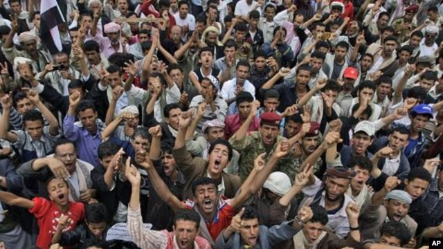 Anti-government protestors shout slogans, during a demonstration demanding the resignation of Yemeni President Ali Abdullah Saleh, in Sanaa, Yemen, July 10, 2011