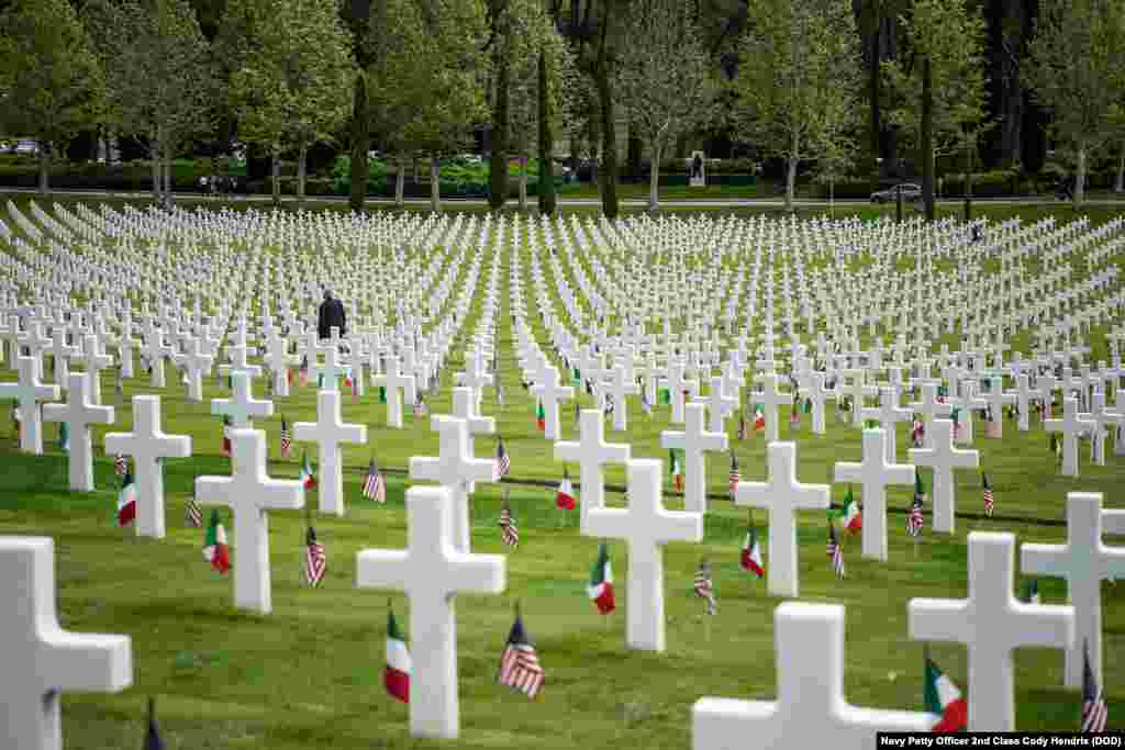 A man walks among the 4,398 tombstones at the Florence American Cemetery during a Memorial Day ceremony in Florence, Italy, May 27, 2019.
