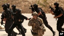 FILE - Special operations forces from Iraq, Jordan and the U.S. conduct a joint exercise.