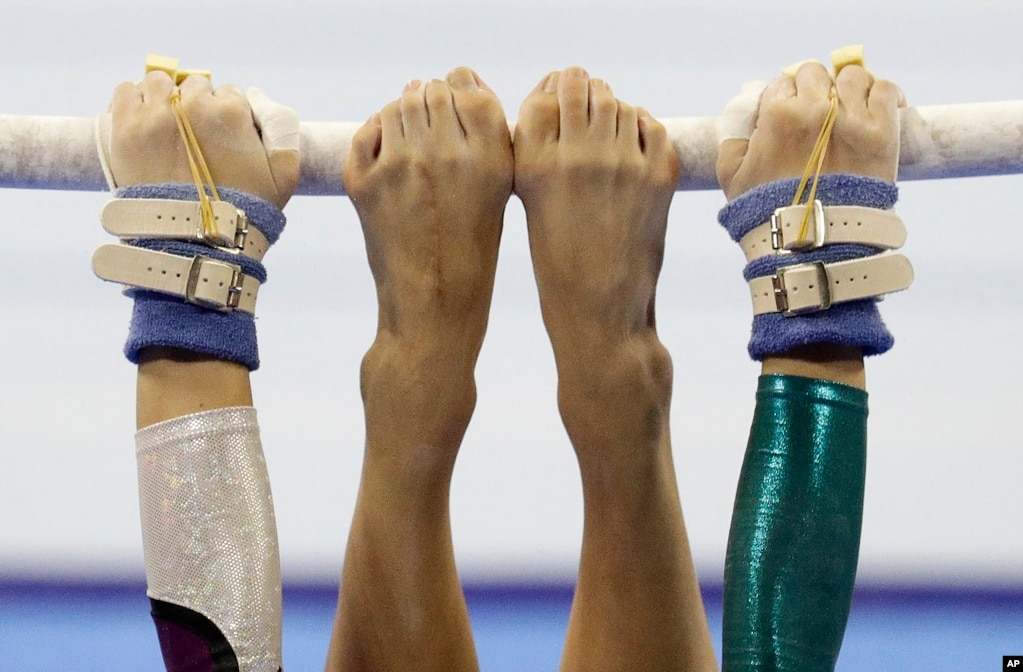 Vietnam's Ngoc Huong Do Thi performs on the uneven bars during the women's artistic gymnastics competition at the 30th South East Asian Games in Manila, Philippines.