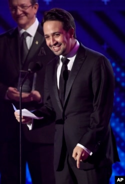 Lin-Manuel Miranda accepts the Latin Recording Academy president's merit award at the 18th annual Latin Grammy Awards at the MGM Grand Garden Arena, Nov. 16, 2017, in Las Vegas.